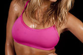 Woman sweat chest pink black — Stock Photo