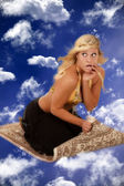 Genie on a flying carpet — Stock Photo