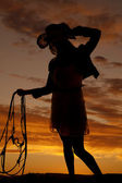 Woman hold bridle sunset — Stock Photo