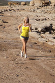 Woman yellow tank run towards — Stock Photo