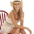 Cowgirl sit on chair — Stock Photo #12249726