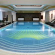 Beautiful indoor swimming pool in the hotel resort — Stock Photo