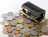 Black purse with coin of different countries — Stock Photo
