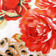 Stock Photo: Silk floral fabric with red rose