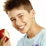 Boy eat apple — Stock Photo #11950433