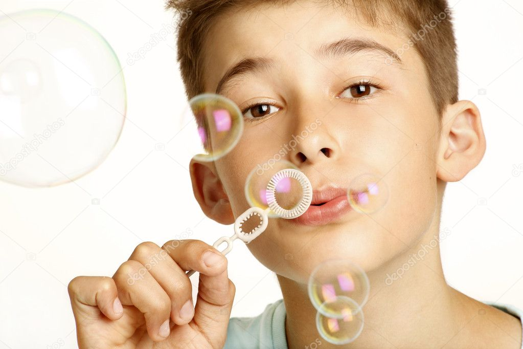 Kid play with bubbles on white — Stock Photo #11950429
