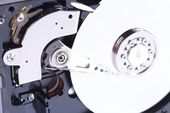 Hard disk and housing — Stock Photo