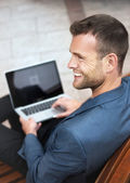 Young Man Sitting with his Laptop — Stock Photo