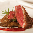 Stock Photo: Duck breast with raspberry sauce and mushrooms
