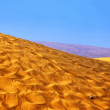 Sand-Dunes-Landscape-with-lilac-mountains-at-horizon — Stockfoto #11968126
