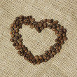Heart of Coffee over canvas — Stock Photo