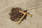 Coffee and canella on canvas — Stock Photo