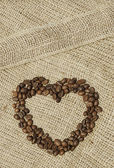 Coffee shaped heart on canvas — Stock Photo