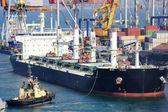 Cargo ship and tug boat — Stock Photo