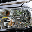 Black modern automobile headlight as background - Stock Photo