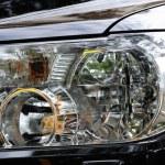 Black modern automobile headlight as background — Stock Photo