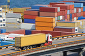 Truck transport container to warehouse near sea — Stock Photo
