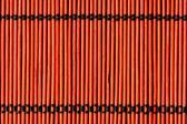 Fondo de paño de tabla de bambú rojo — Foto de Stock