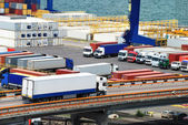 Truck carries container to warehouse near sea — Stock Photo