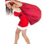 Santa claus woman carrying bag — Stock Photo #11982545