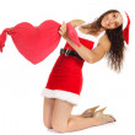 Santa woman holding heart shape — Stock Photo #11982595