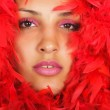 Woman portrait in red feather — Stock Photo #11983018