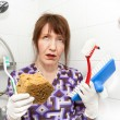 Stock Photo: Bored housekeeper