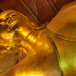 Royalty-Free Stock Photo: Golden lying buddha