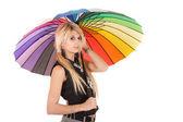 Schoolgirl en regenboog paraplu — Stockfoto