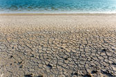 Dry soil and water — Stock Photo