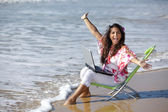 Woman working at sea — Stock Photo