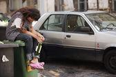 Drunk woman sitting on bin — Stock Photo