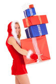 Christmas woman carrying gift pile — Stock Photo