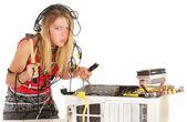 Woman breaking computer — Stock Photo