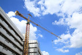 Yellow crane against blue sky and cloud — Stock Photo