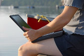 Laptop by the water — Stock Photo