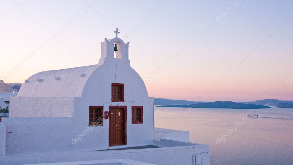 Greek church in santorini greece with a cross — Stock Photo #12003754