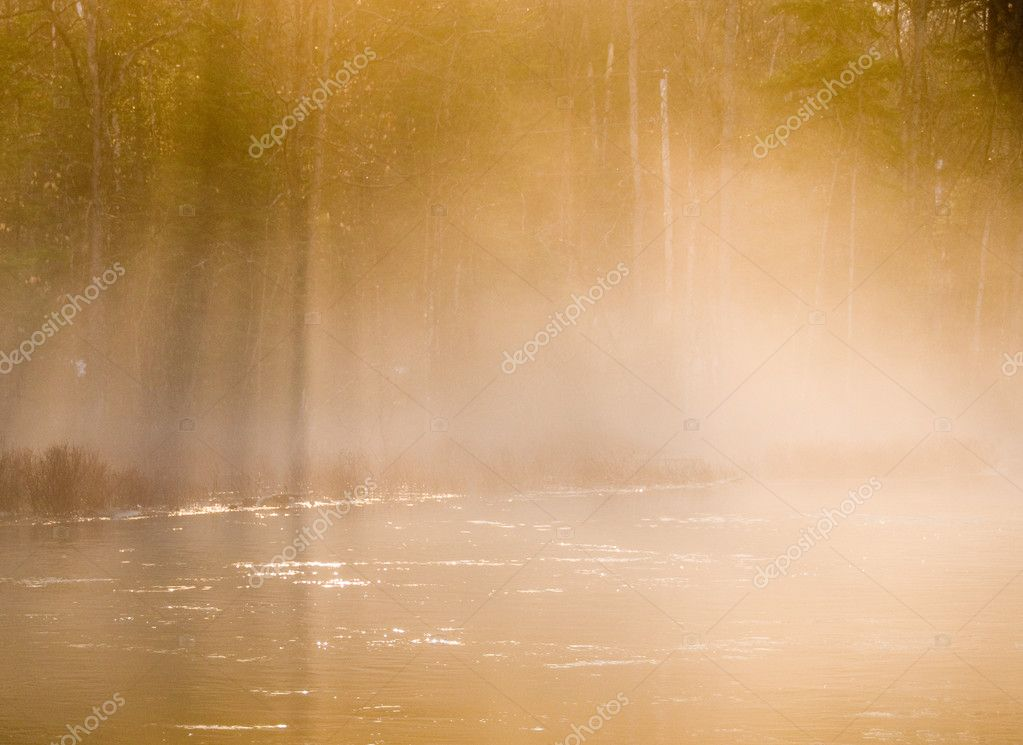 Moring mist in warm orange glow on the river — Stock Photo #12003855