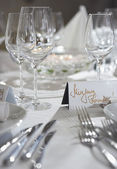 Fancy table set for a wedding party event dinnerand card on a ta — Stock Photo