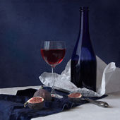 Still life in blue with wine and fig — Stock Photo