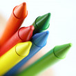 Colored crayons in hand - Stock Photo