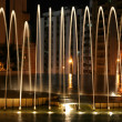 Beautiful lit fountain at night — Stock Photo