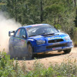 Stock Photo: Subaru world rally car competing on Portugal Rally 2007