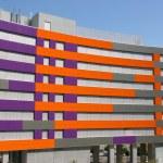 Purple and orange office building — Stock Photo #12052339