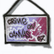 "Grafitti sign ""crime on canvas"" isolated on white — Stock fotografie"