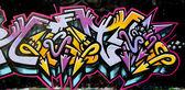 Grafitti tag yellow and purple — Stock Photo