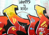 Grafitti tag cut image with graffiti is dead sign — Stock Photo