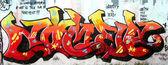 Grafitti tag bild mit mehreren werbezeilen um — Stockfoto