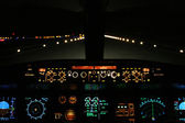 Aircraft landing at night with runway ahead — Stock Photo