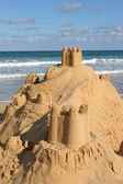 Sand castle by the sea — Stock Photo
